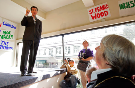 San Francisco Mayor Gavin Newsom (L) speaks at the official opening of his campaign headquarters in San Francisco