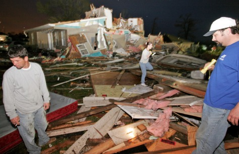 IMAGE: RESIDENTS LOOK FOR BELONGINGS AFTER STORM