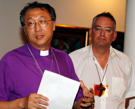 Archbishop of South East Asia Chew and Archbishop of Australia Aspinall attend a news conference during the summit of Anglican primates in Dar es Salaam