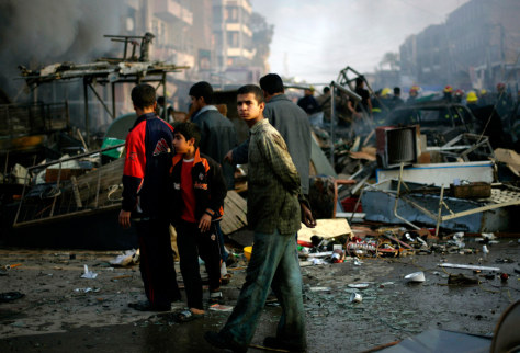 An Iraqi boy walks through destroyed market in the neighborhood of New Baghdad, Iraq.