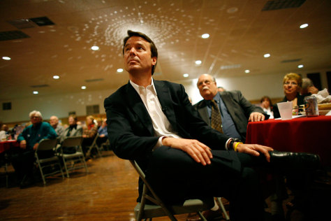 Image: John Edwards waits to speak in Davenport, Iowa