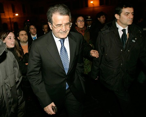 Italy's Prime Minister Romano Prodi walks from his offices after resigning in Rome Feb. 21