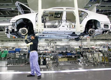 Toyota worker assembles a Lexus