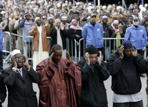 Men pray outside the Islamic Cultural Center, the Bronx, NYC