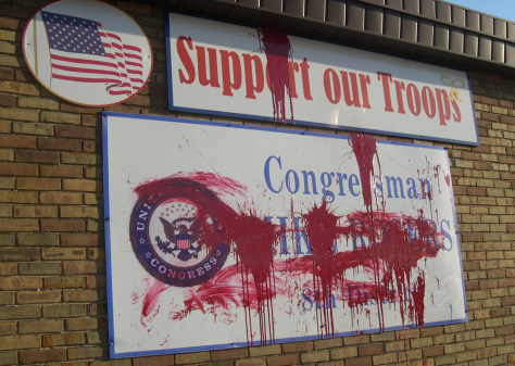 IMAGE: RED PAINT ON LAWMAKER'S OFFICE SIGNS