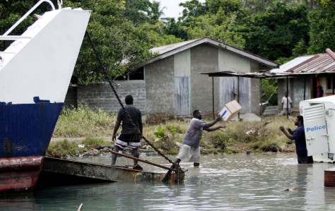 Image: Aid workers in Solomon Islands.