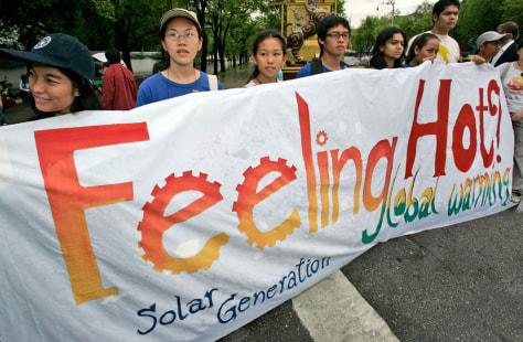 IMAGE: ACTIVISTS OUTSIDE UN BUILDING IN BANGKOK