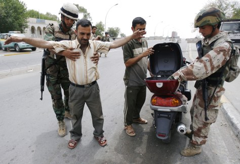IMAGE: IRAQI POLICE SEARCH MOTORCYCLIST