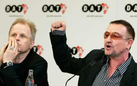 U2 lead singer Bono and German singer Groenemeyer address a news conference to present the DATA 2007 report in Berlin
