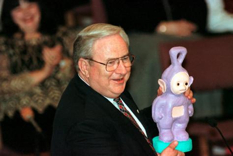 Image: Falwell holds toy Teletubbie