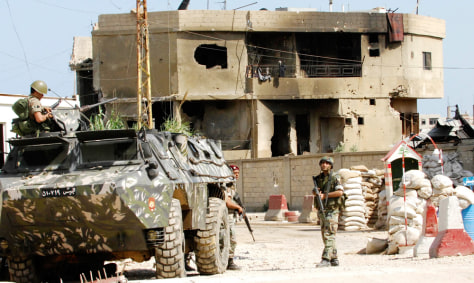 Lebanese soldiers patrol the main entrance of the Nahr al-Bared Palestinian refugee camp in northern Lebanon
