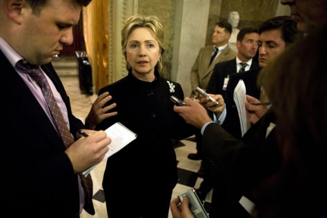 IMAGE: Sen. Clinton talks to reporters