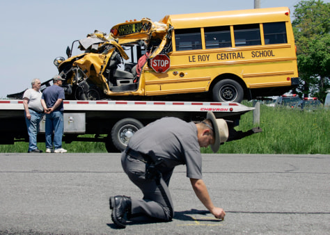 IMAGE: NY state trooper reconstructs bus accident scene