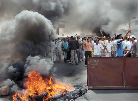 IMAGES: Protestors burn tires in Gurgaon, India.