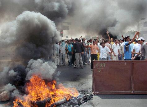 IMAGES: Protestors burn tires in Gurgaon, India.