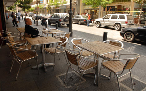 Image: Man sits at street cafe in Lebanon