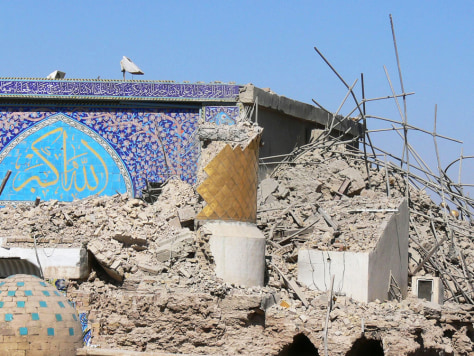IMAGE: Destroyed golden minarets at the shrine of the Askariya mosque in Iraq.