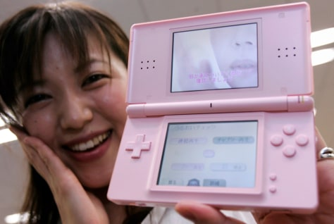 Konami Digital Entertainment Co's designer Nishimura poses with Dream Skincare software for Nintendo DS in Tokyo