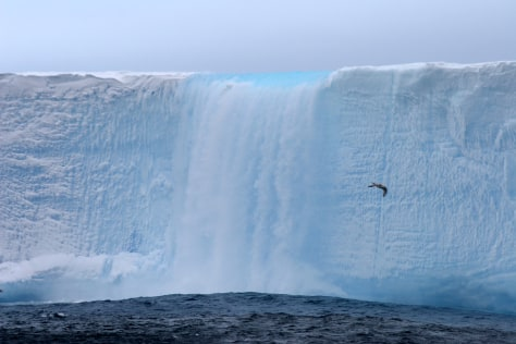 IMAGE: WATER CASCADES OFF ICEBERG