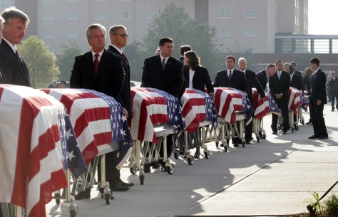 IMAGE: Caskets at memorial service