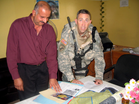 Image: Tom Deierlein and a staffer with the Iraqi Assistance Center