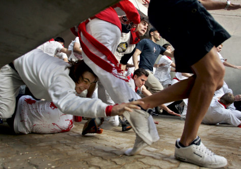 Image: Running of the bulls in Pamplona, Spain