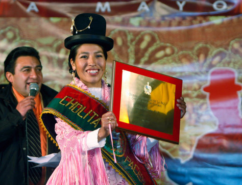 Mariela Molinedo, winner of the Miss Cholita Pacena 2007 pageant, holds up her winner's plaque in La Paz