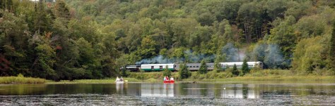 Image: Canoeists on Moose River watch the Adirondack Scenic Railroad train