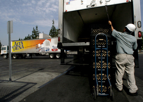 Image: Worker unloads milk crates