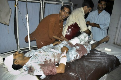 IMAGE: Pakistani paramedical staff give initial treatment to an injured victim of a rocket attack in Pakistan.
