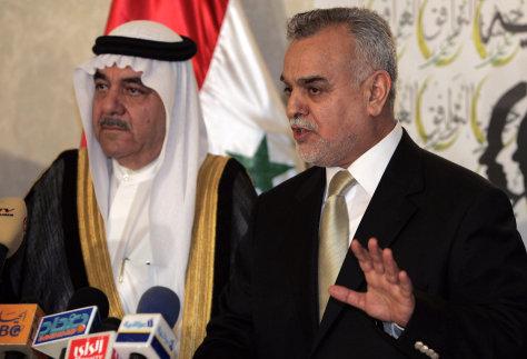 IMAGE: Iraq's Vice President Tareq al-Hashemi and Khalif Alyan.