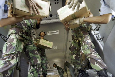 IMAGE: Indonesian military rescue team loads boxes