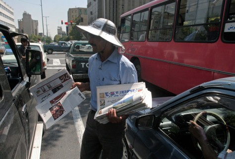 Image: Man peddling the daily Shargh
