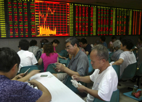 Image: People play cards at a stock exchange in Nanjing
