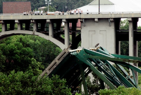 Image: Collapsed bridge, onlookers.