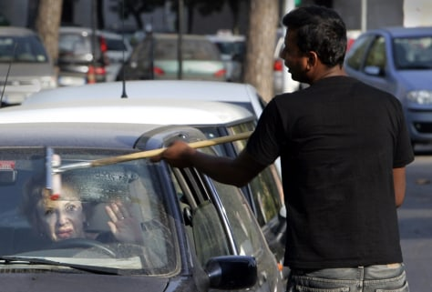 Image: Rome squeegee man