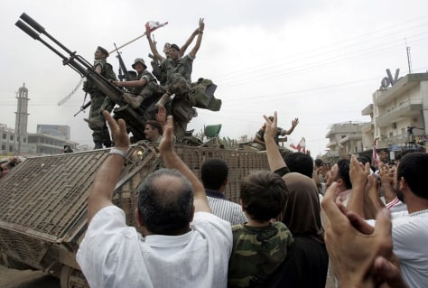 Image: Lebanese soldiers celebrate.