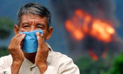 Image: Man near gas pipeline leak
