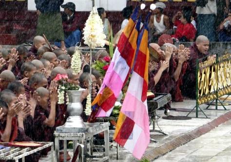 IMAGE: Buddhist monks say prayers.