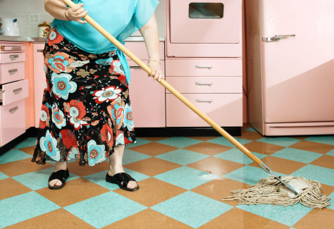 Image: Mopping the kitchen floor