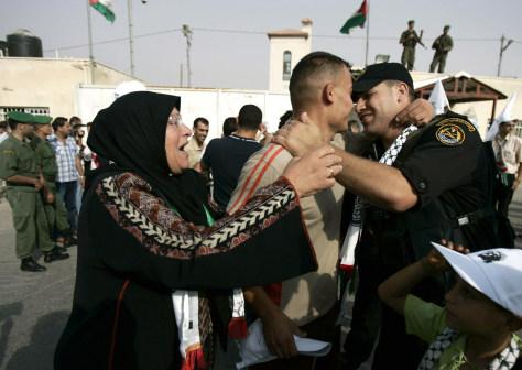 IMAGE: FREED PRISONER HUGGED BY RELATIVES