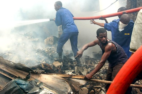 IMAGE: RESCUERS IN PLANE WRECKAGE
