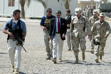 File photo of U.S. civil administrator in Iraq Paul Bremer being escorted by Blackwater personnnel on his arrival at U.S. Army 82nd Airborne Division headquarters in Ramadi