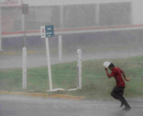 Image: Mexican man getting wet