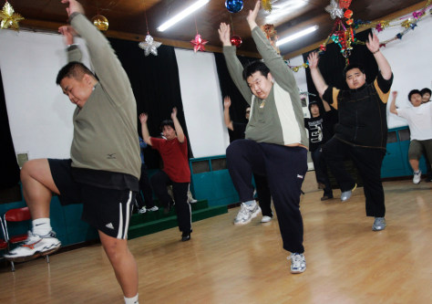 Patients perform aerobics at the Aimin Fat Reduction Hospital in the city of Tianjin