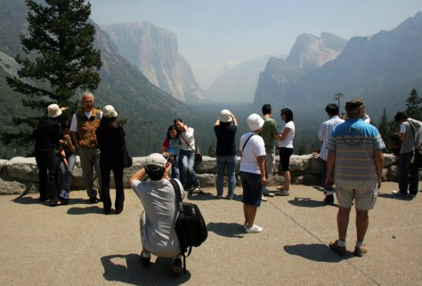 Image: Tourists take photos  in Yosemite.