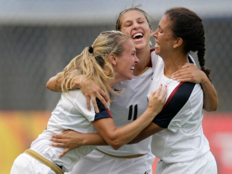 Carli Lloyd of the U.S. celebrates her goal against Japan with team-mates Heather Mitts and Shannon Boxx at the Beijing 2008 Olympic Games in Qinhuangdao