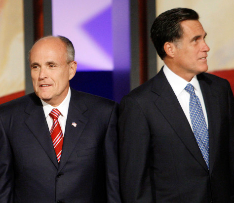 Republican presidential candidates John McCain, Rudy Giuliani and Mitt Romney stand on stage