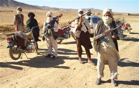 Image: Men claiming to be Taliban fighters
