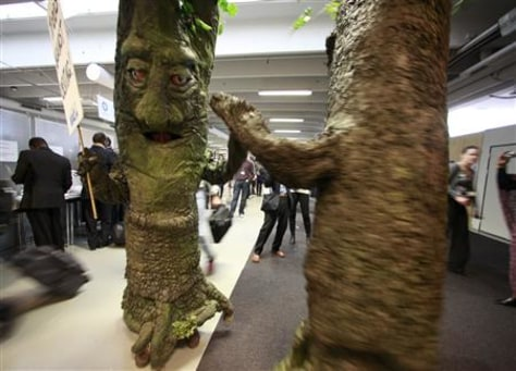Image: Activists dressed as trees